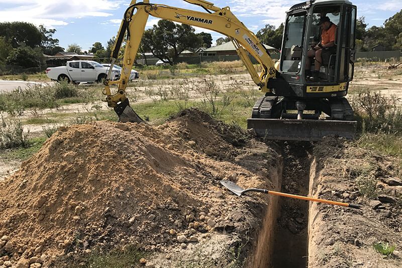 Site Investigation - Test Pitting: Excavator with Bucket